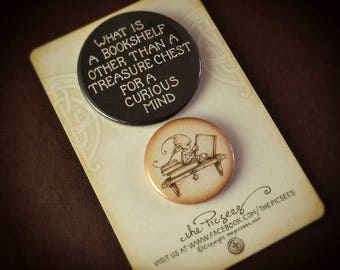 A pair of PIN BUTTON BADGES featuring a Big & Small badge about bookshelves and the treasures they hold...by the Picsees