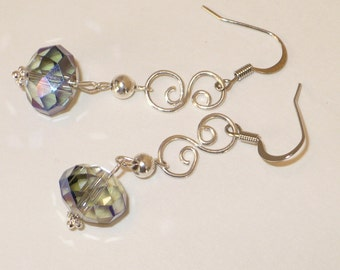 Firepolished rondelle crystal with silver scrolls earring.