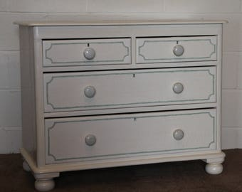 A Victorian Painted Pine Two over Two Graduated Chest of Drawers