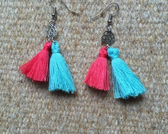 Dangling earrings with turquoise and pink PomPoms