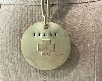 Trust stamped brushed gold metal necklace