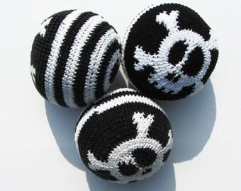 With skull pattern juggling balls.