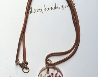 Handcrafted suede necklace with floral charm