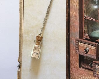 Spells and potion bottle pendant