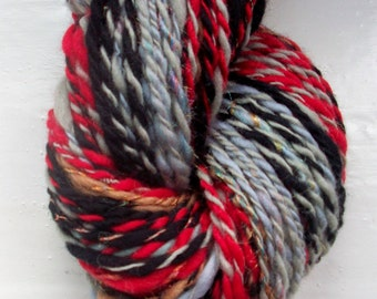 Handspun art yarn -  merino, rainbow sparkle, red, black, grey, 95g by SpinningStreak