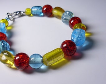 Beaded Bracelet, Inspired by thé primary colors! Red, Yellow and Blue glass beads of différent shapes and styles. Durable, High quality.