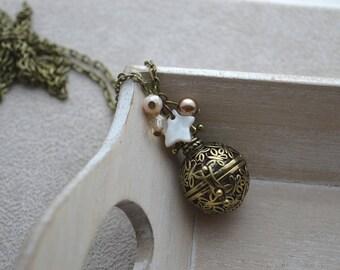 Bola de grossesse, ton beige, étoile en nacre, perles en cristal et cristal nacré de Swarovski