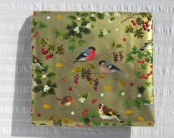 "One piece of vintage heavy weight wrapping paper, lovely bird varieties and fruited branches on gold background, 30"" x 40""."