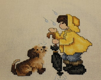 Boy and his Dog in the Rain Finished Cross Stitch - Design from Stoney Creek Collection