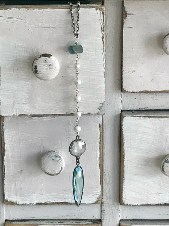Morning mist. Aqua quartz pendant and faveted crystal dangle from aurora borealis aquamarine and pyrite. Long neckace by ladeDAH!