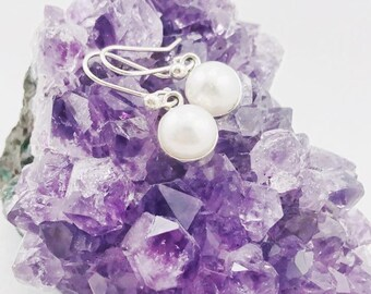 Handcrafted pearl drop earrings made from genuine .925 sterling silver