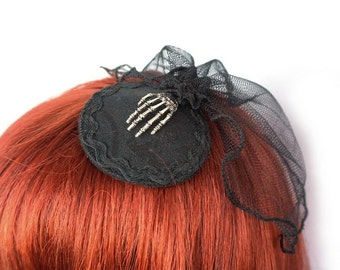 Gothic Fascinator with skeleton hand and a small veil