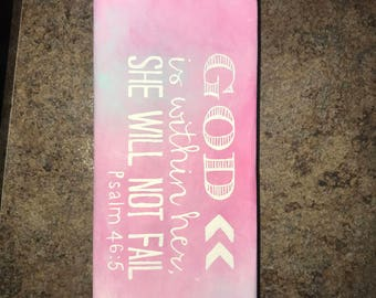 Quote painted on wood: God is within her, she will not fail. psalm 46.5