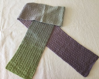 Reversible hand knit scarf in green and lavender