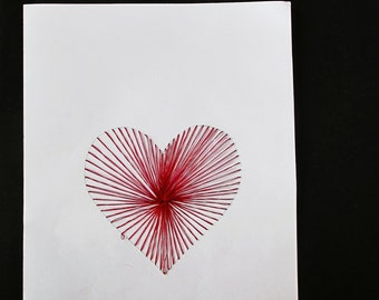 Greeting card with yarn heart