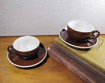 Two (2) Brown Pottery Teacup and Saucer Sets