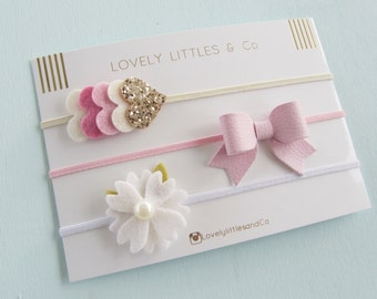 Baby/Girl Pink leather bow, white daisy flower, and gold heart collection, headbands.