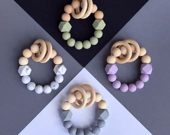 Rattling teether. Pastel colors