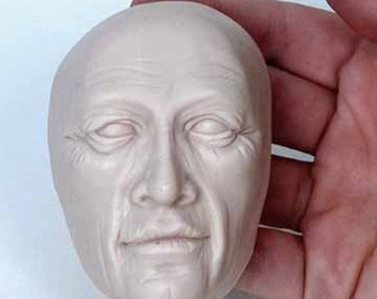 Moldf3 - 3 inch St. Nicholas-type face mold.  Serious Male Face, by Maureen Carlson