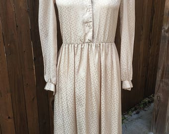 Vintage 1980s Willi of California day dress. Sand colored polka dot silky jacquard fabric.