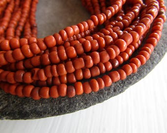 orange seed glass beads , opaque orange No2 ,  rustic color small organic barrel tube Indonesian 1.5  to 4  mm / 44 inches  strand 7ab30-5