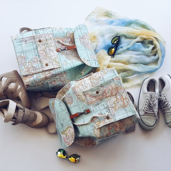 Two world map prints backpack for couples two atlas large like this item gumiabroncs Choice Image