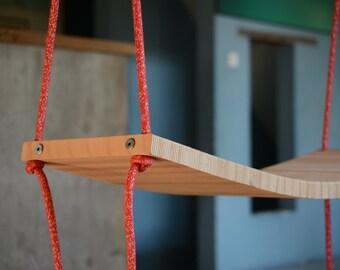 Flexible wooden swing for indoor