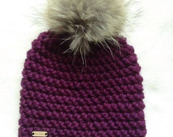 A crochet Beanie, super bulky, very large fur Pom Pom, lined with fleece, woman