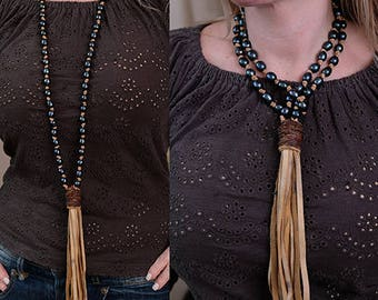 necklace with all dark freshwater pearls. hand knotted deerskin leather with amazing tassel