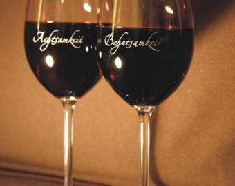 "2 wine glasses, lovingly engraved with ""Happiness"" and ""Joie de vivre"""