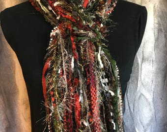 Unique fashion scarf in shades of red, green, black, white, silver and gold