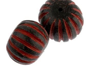 Carved cinnabar black on red round. 18x15mm. Pkg of 1. b7-cin212a
