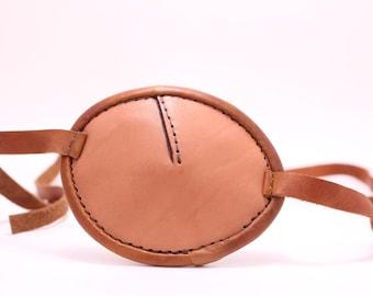 Tan leather eye patch