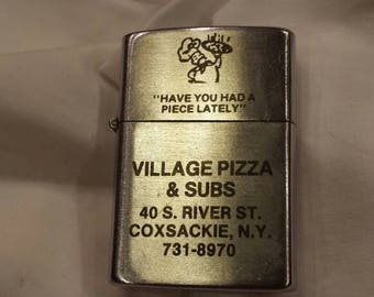 "Vintage Advertising Lighter for Village Pizza & Subs Coxsackie-NY 731-8970. Slogan ""Have You Had a Piece Lately"". Working Condition.  V Nice"