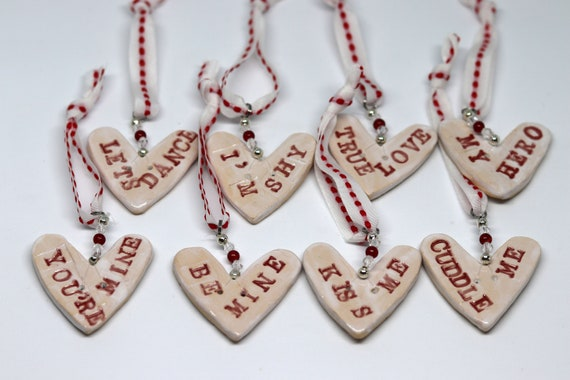 Choose from True Love, Lets Dance, I'm Shy, Be Mine, Kiss Me, Cuddle Me, You're Mine, My Hero Pottery Hearts, Anniversary, Wedding, Love.