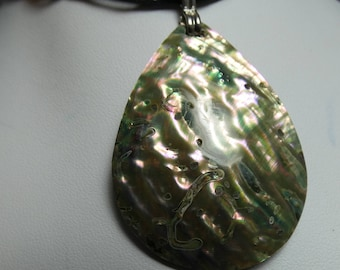 Beautiful Shell Pendant on cord with bead & loop closure. The shell is outstanding -shell 40X50mm 2263