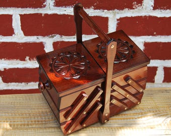 New beautiful small wooden sewing box in brown color