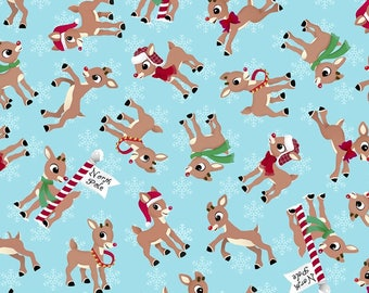 NEW for Christmas 2017!!  Tossed Rudolph the Red-Nosed Reindeer on Blue Cotton Christmas Fabric by the yard and by the half yard