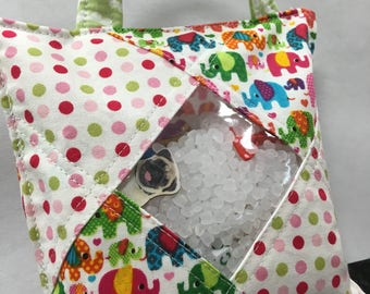 Treasure Bag filled with 30 little surprises. I spy bag great for sensory seekers.