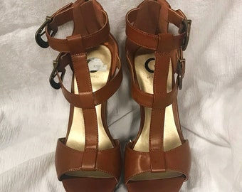 Guess Women's size 11M Brand New leather brown wedge heels. Strap 5 inches tall wood heel