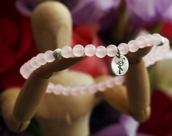 Lovely selection of semi precious and sterling silver beads bracelet with a hand stamped hand cut sterling silver disc