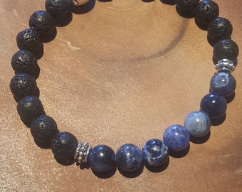 Natural Blue Sodalite and Lava Stone beaded (8mm) men's bracelet with Skull charm.