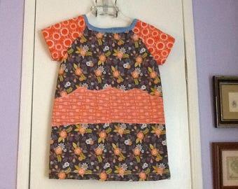 Handmade girls dress size 5, brown floral, orange circle design sleeves