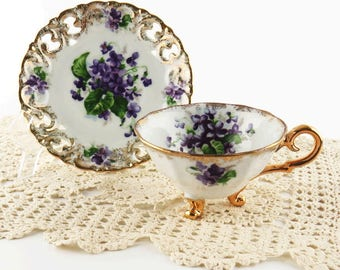 Mid Century Purple Violets Footed Teacup and Saucer Registered Celebrate Made in Japan Scallop Edge Gold Gild Slotted Porcelain Mothers Day