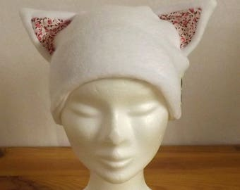"""White """"Chapocha"""" child's Fleece hat with pink flowers"""