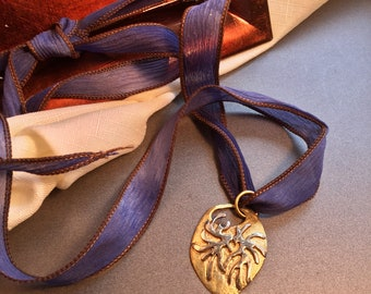 Ala Matisse brass and german silver pendant on adjustable silk chenille ribbon