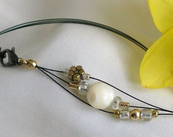 Three-stranded forearm or upper arm bracelet*gold, white,clear beads in multi-stranded bracelet* beads and flower charm adjustable bracelet