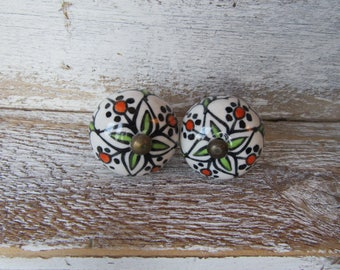 2 Hand Painted White Green Orange Black Ceramic Knobs with Antiqued Brass Accent for Drawers or Cabinets Each is a little Different B-25