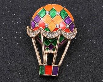 Stunning, enameled, colourful, metal hot air balloon brooch.