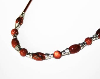 Mid-length necklace made of Gold Stone gemstone and Tibetan silver cones